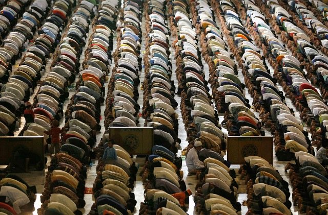 Muslims attend prayers on the eve of the first day of the Islamic fasting month of Ramadan at Al Akbar mosque in Surabaya, East Java, Indoneisia on August 21, 2009.