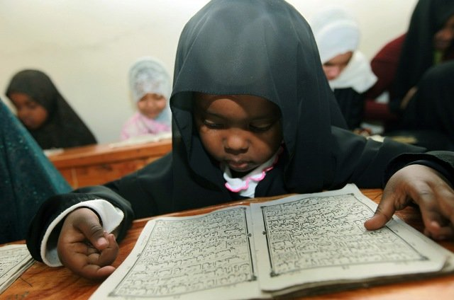 A Kenyan child reads verses from the Quran on the fifth day of the Muslim holy month of Ramadan in a Madrassa in Nairobi, Kenya on Wednesday, Aug. 26, 2009.