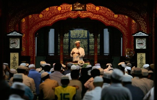 Muslims attend Friday prayers on the first day of the holy month of Ramadan at a mosque in Beijing, China on August 21, 2009.