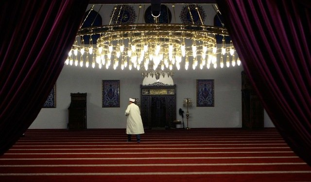 A man arrives for the evening prayers of the first day of the Islamic fasting month of Ramadan at Merkez mosque in Duisburg, Germany on August 21, 2009.
