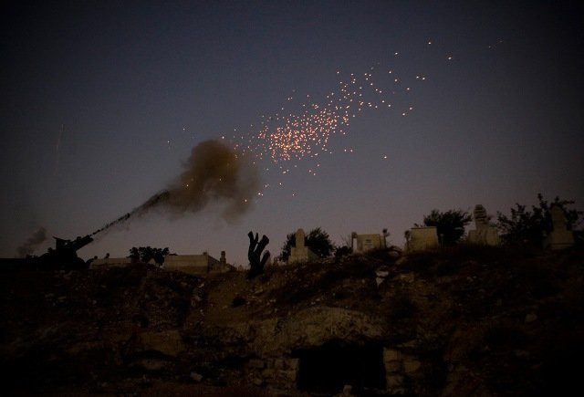 A cannon fires as part of the ceremony that ends the second day of the Muslim holy fasting month of Ramadan, outside Jerusalem's Old City Sunday, Aug. 23, 2009.