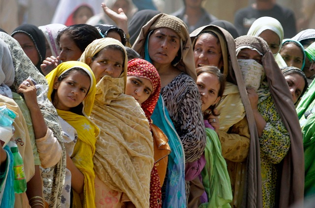 Pakistani women line up for subsidized sacks of flour provided by the government for the holy month of Ramadan, Saturday, Aug. 22, 2009 in Rawalpindi, Pakistan.