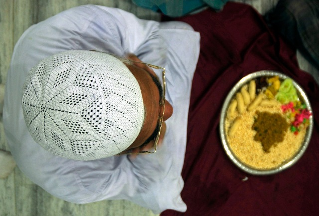 A Muslim man sits before breaking his fast on the second day of the holy month of Ramadan at a mosque in Agartala, capital of India's northeastern state of Tripura on August 24, 2009.