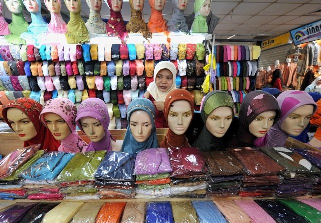 A vendor of headscarfs waits for customers in the 4th day of Ramadan at a market in Jakarta, Indonesia on August 25, 2009.