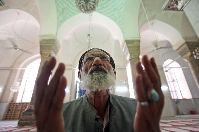 A man prays at a Sunni mosque in Baghdad, Iraq, Sunday, Aug. 23, 2009.