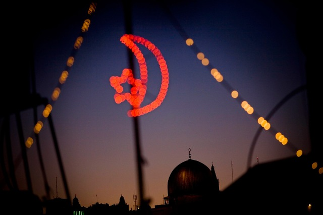 The Dome of the Rock, or Masjid Qubbat As-Sakhrah, one of the holiest sites in Islam, is seen on the Temple Mount in Jerusalem through festive lights for Ramadan on Tuesday, Aug. 25, 2009.